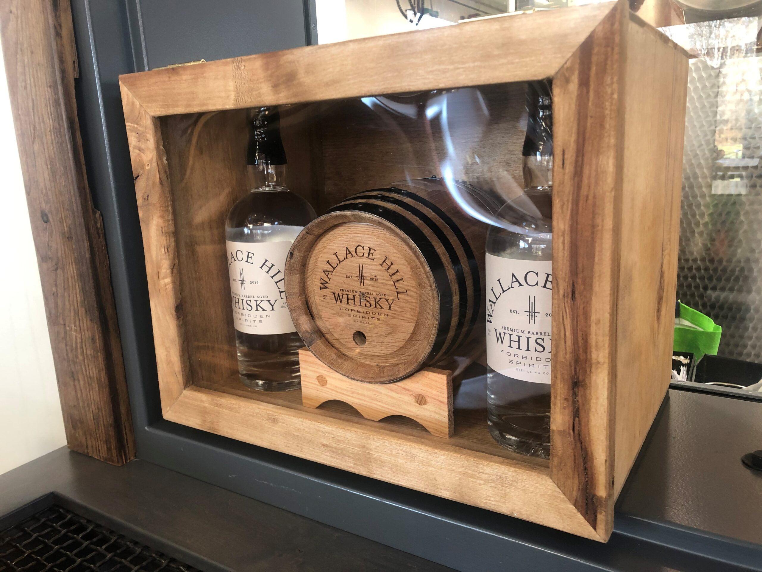 Wallace Hill Whisky Gift Set including two bottles of Wallace Hill 45% ABV white spirit, oak aging barrel, and wooden gift box.